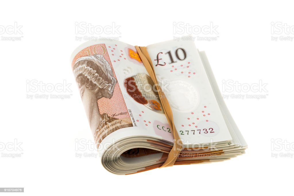 Bundle of UK ten pounds banknotes stock photo