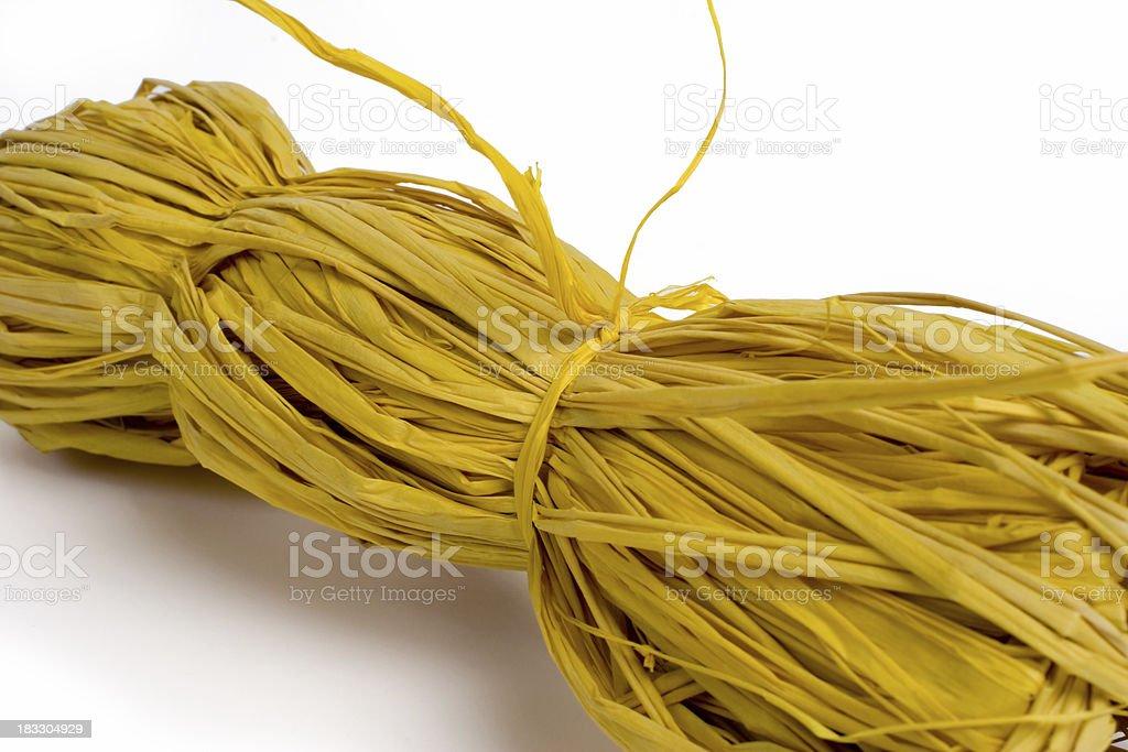 Bundle of yellow raffia string stock photo