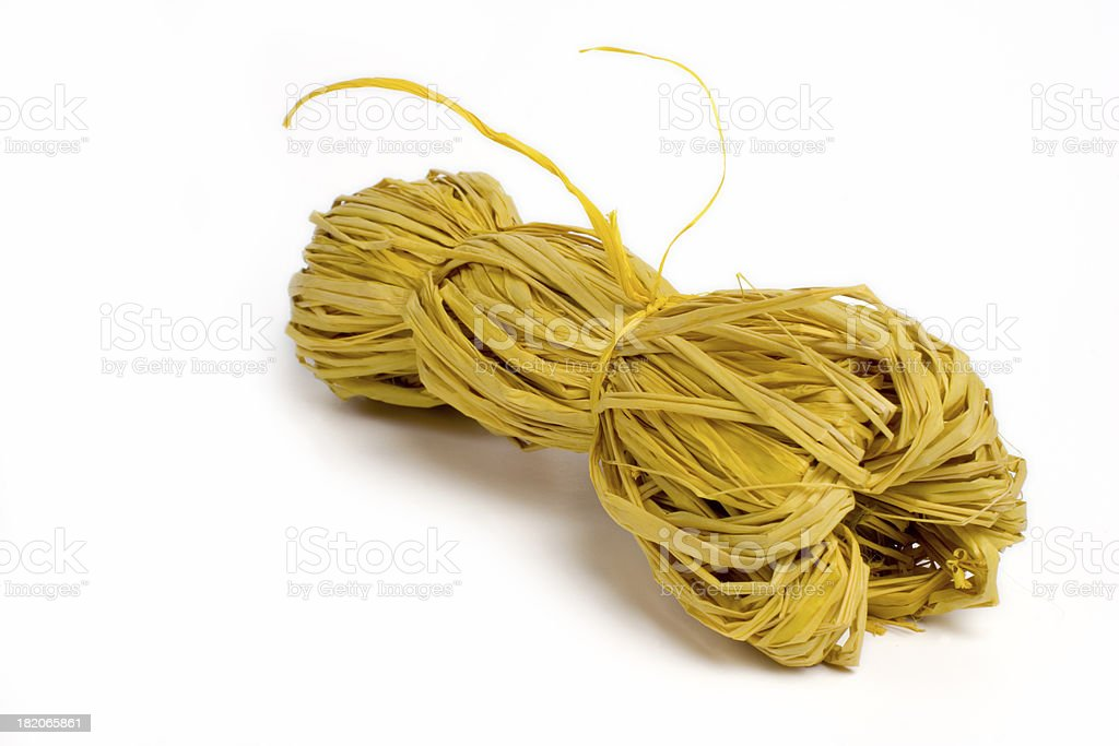 """Bundle of yellow raffia wire """"Yellow raffia wire on white, isolated background."""" Activity Stock Photo"""