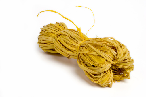 Bundle Of Yellow Raffia Wire Stock Photo - Download Image Now