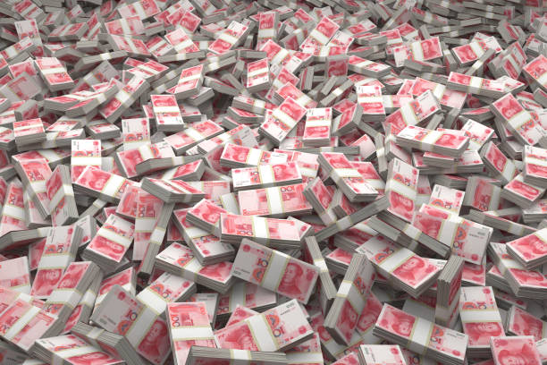 Bundles of Chinese ¥100 Yuan Notes Bundles of Chinese ¥100 Yuan Bills are laid out in a massive heap. Millions and billions of Yuan. chinese currency stock pictures, royalty-free photos & images