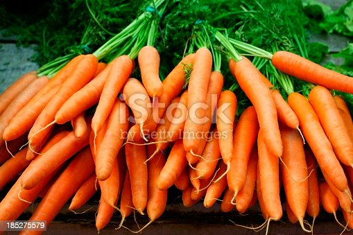 istock Bundles of organic carrots with the stems still attached 185275579