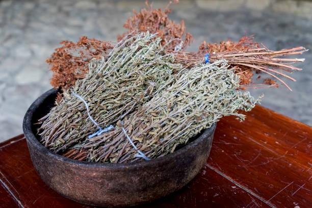 Bundles of sun dried Thyme in a pot, Thymus Vulgaris stock photo