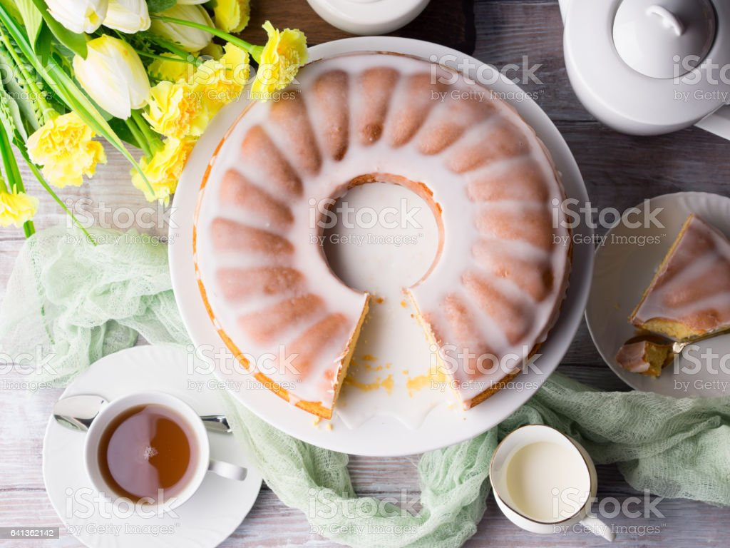 Bundt cake with frosting. Easter festive dessert stock photo