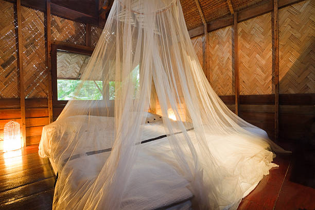 Bungalow bedroom. Bedroom in a wood bungalow. Horizontal shot. netting stock pictures, royalty-free photos & images