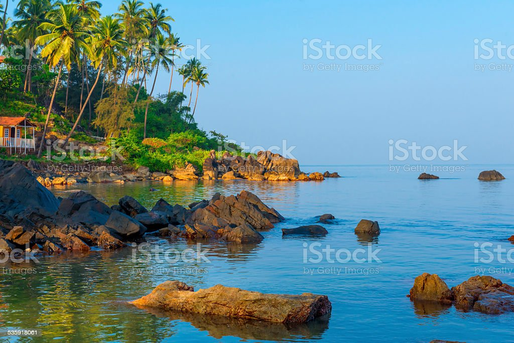bungalow on the beautiful rocky coast of ocean stock photo