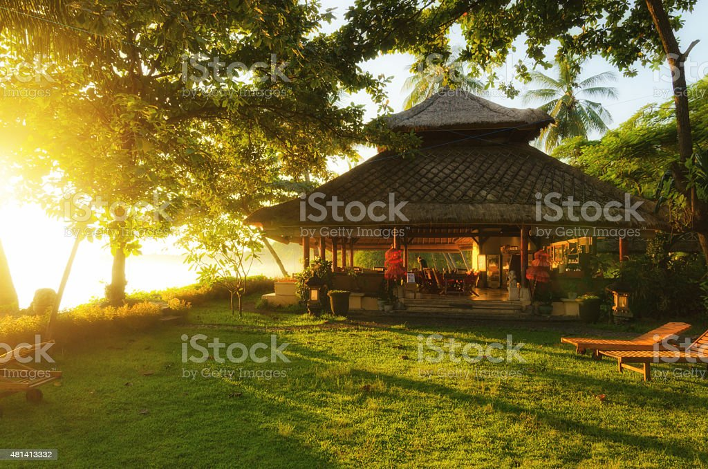 bungalow resort in sunrise at the cost of Bali Indonesia stock photo
