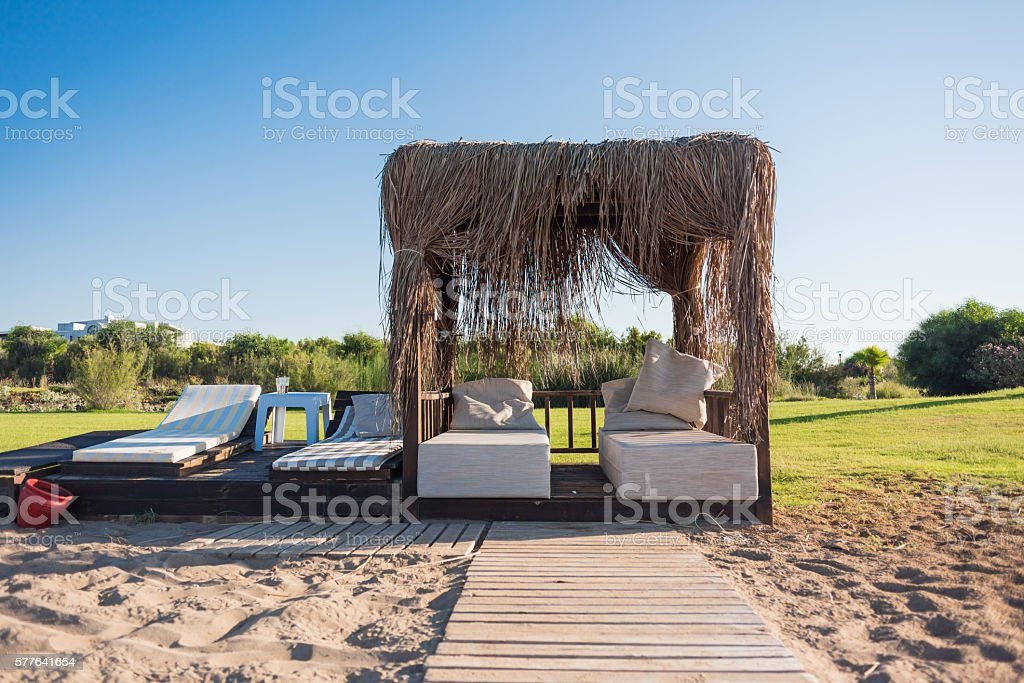 Bungalow with sun loungers stock photo