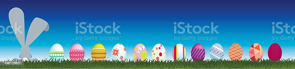 Bunny and easter eggs viewed from behind royalty-free stock photo