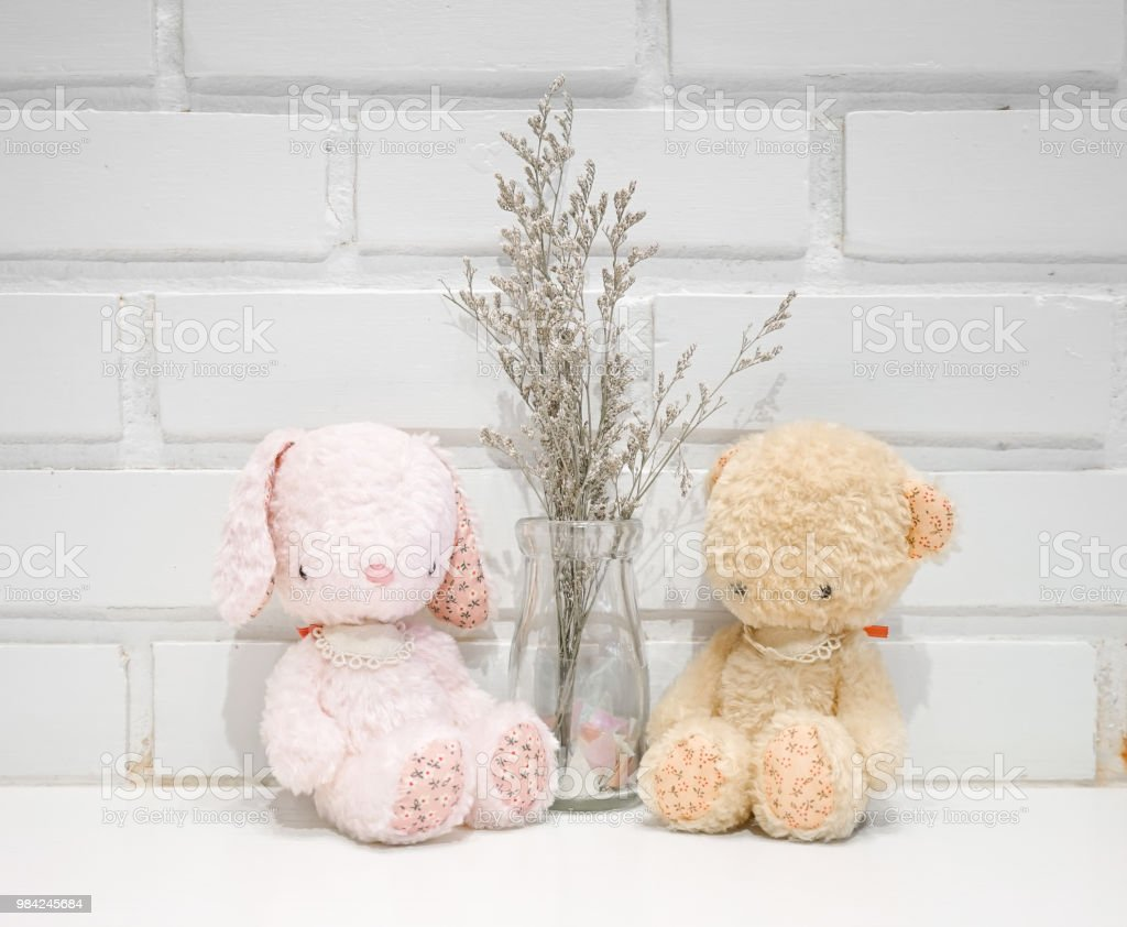 bunny and teddy. Cute stuffed animals of pink rabbit doll and brown...