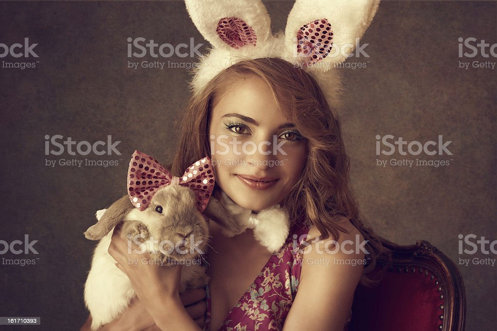 bunny girl holding a rabbit stock photo