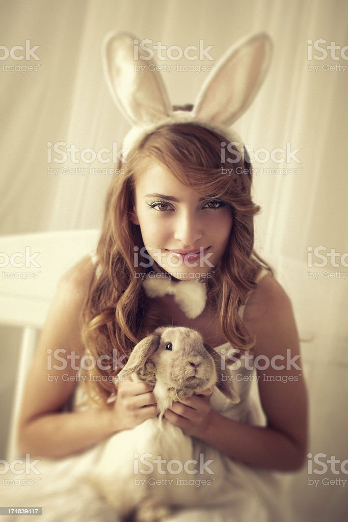 bunny girl with a rabbit royalty-free stock photo