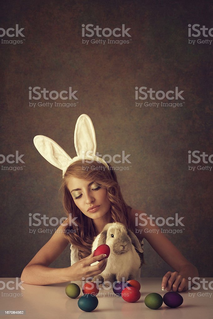 bunny girl with baby rabbit and easter eggs royalty-free stock photo