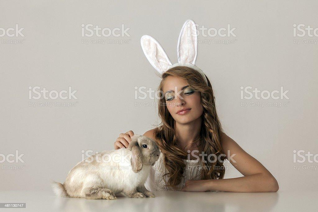 bunny girl with baby rabbit stock photo