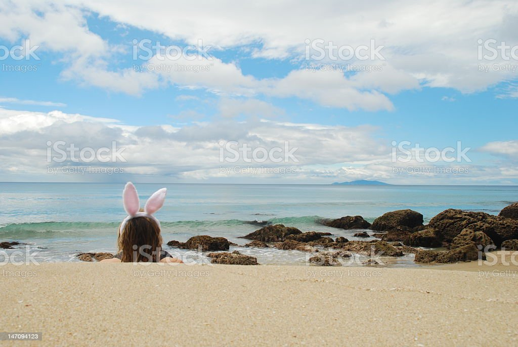 Bunny relaxing on the Beach stock photo