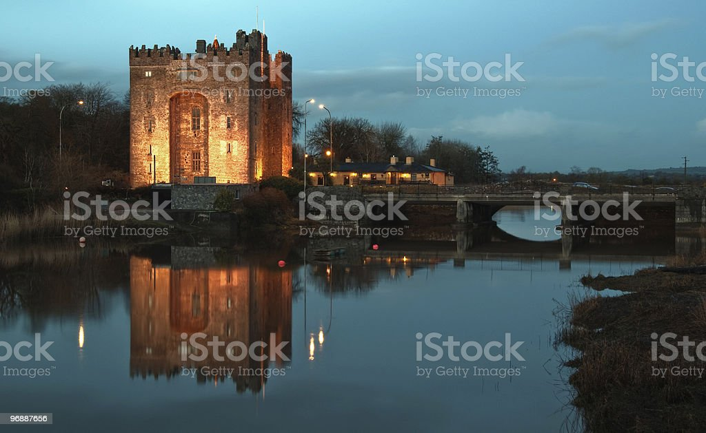 bunratty castle at night over looking a river stock photo