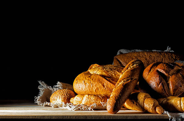 Buns and bread on the table. stock photo