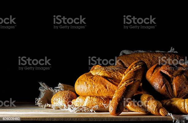 Buns And Bread On The Table Stock Photo - Download Image Now