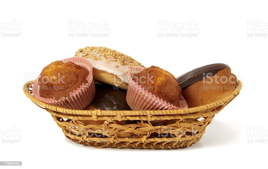 Buns and muffins in the basket royalty-free stock photo