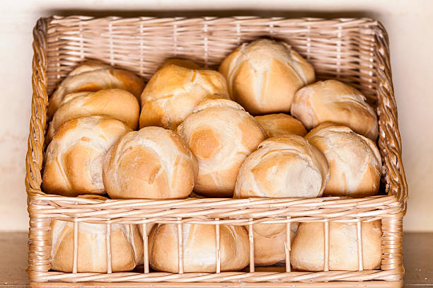 Buns in a basket Michetta bread round loaf stock pictures, royalty-free photos & images
