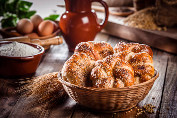 Buns of bread with sesame and poppy seeds in a wicker basket stock photo