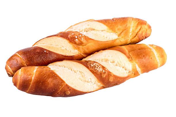 buns rolls lye rolls typical german bread isolated on white - laugenstangen stock-fotos und bilder