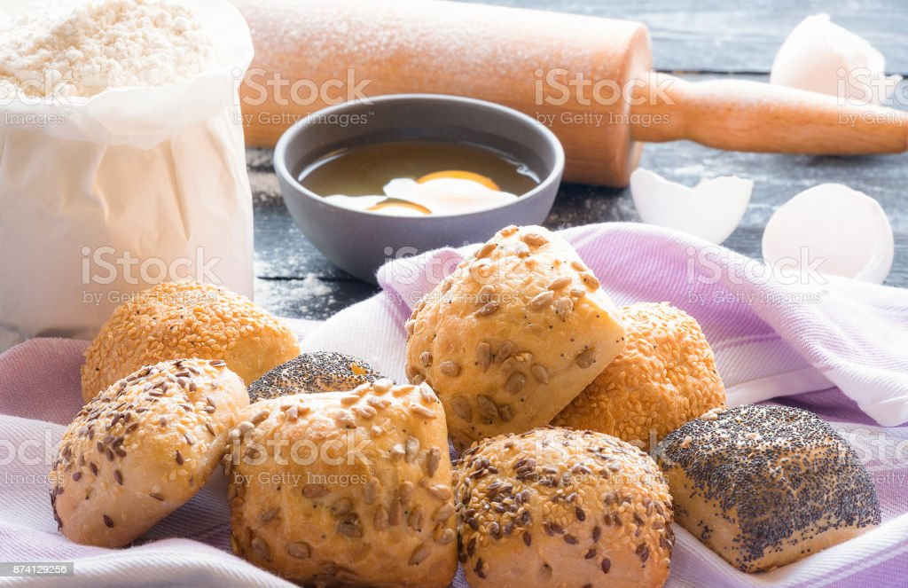 Buns with seeds and ingredients stock photo