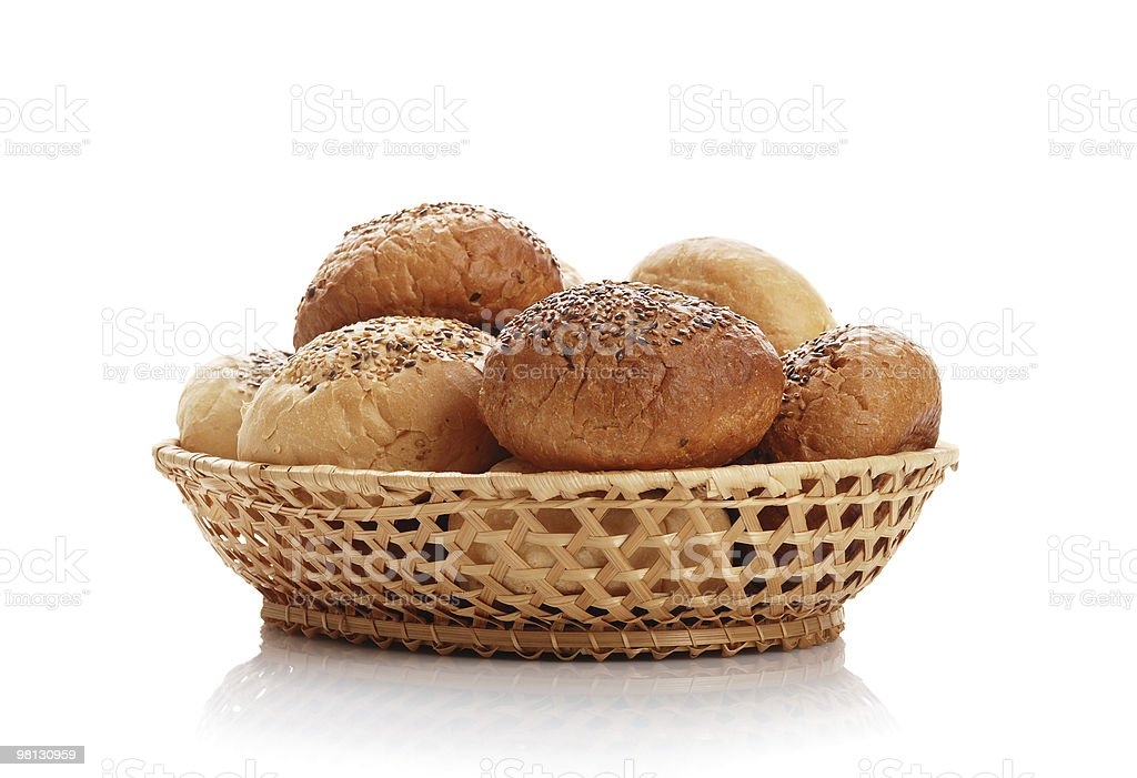 Buns with sesame in a woven basket royalty-free stock photo