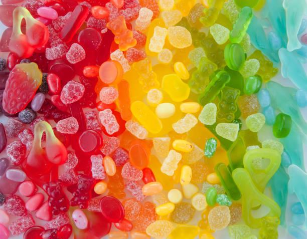 Bunte Fruchtgummi Suesse Fruchtgummi in verschiedenen Farben und Formen jujube candy stock pictures, royalty-free photos & images