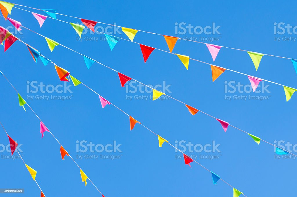 Bunting flags fluttering on an open sky stock photo