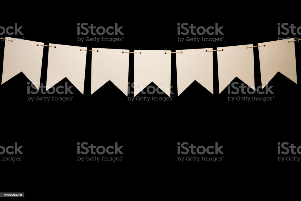 Bunting, seven white shapes on string for banner message stock photo