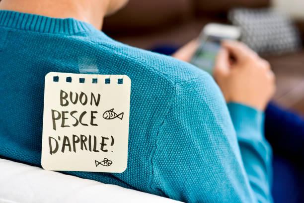 buon pesce d aprile, happy april fools day in italian - april fools stock photos and pictures