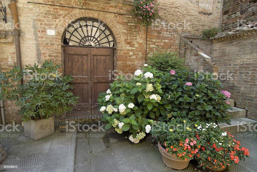 Buonconvento (Siena, Tuscany, Italy) - Door and potted plants royalty-free stock photo