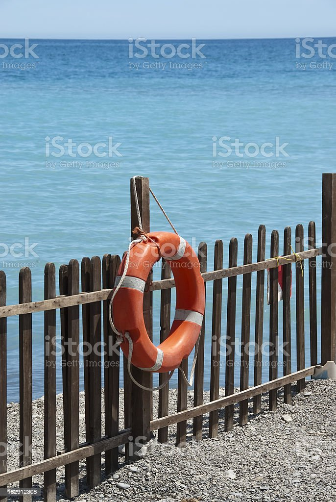 buoy attached to the fence royalty-free stock photo