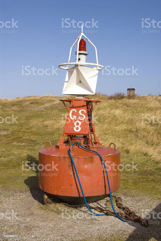 Buoy in the Dunes stock photo