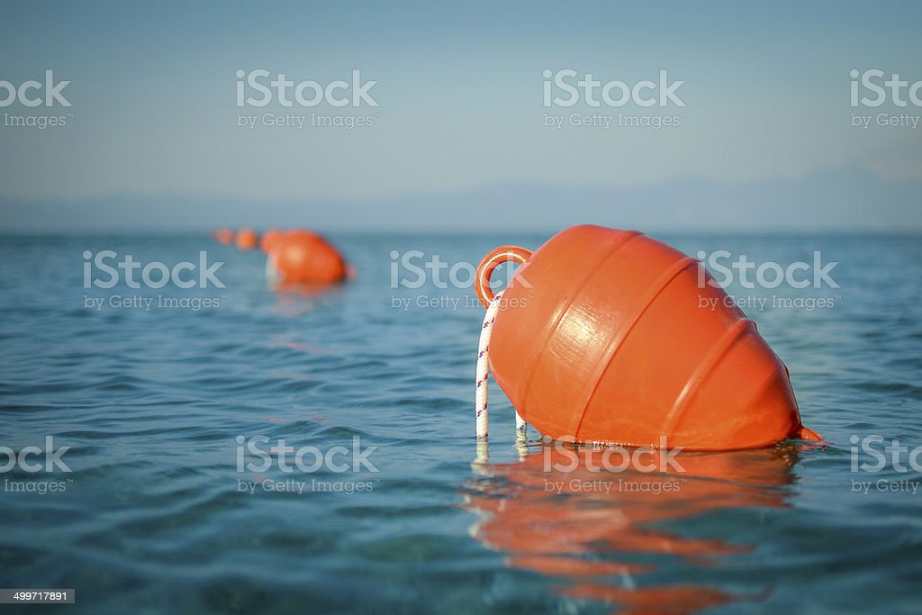 buoy in the ocean stock photo