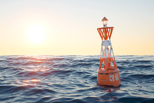 buoy in the open sea on the sunset background. - boje stock-fotos und bilder