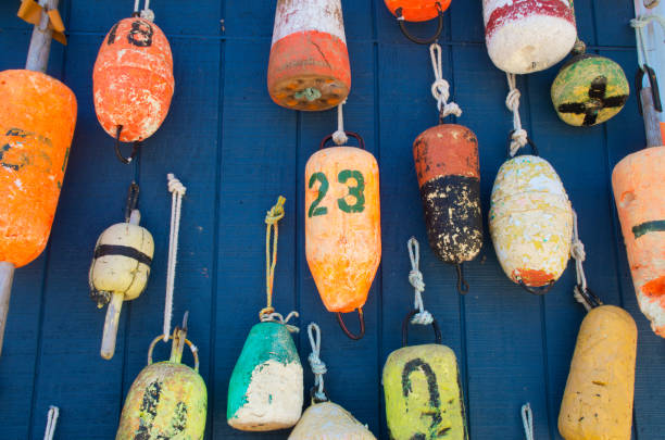 Buoy Wall Buoys decorate a wall of a house in Myrtle Beach South Carolina buoy stock pictures, royalty-free photos & images