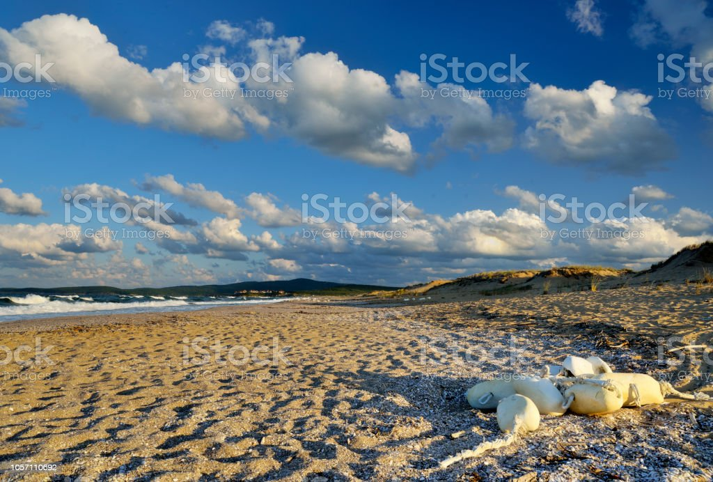 Buoys on the sand after sea storm in Alepu bay near Sozopol town, Bulgaria. stock photo