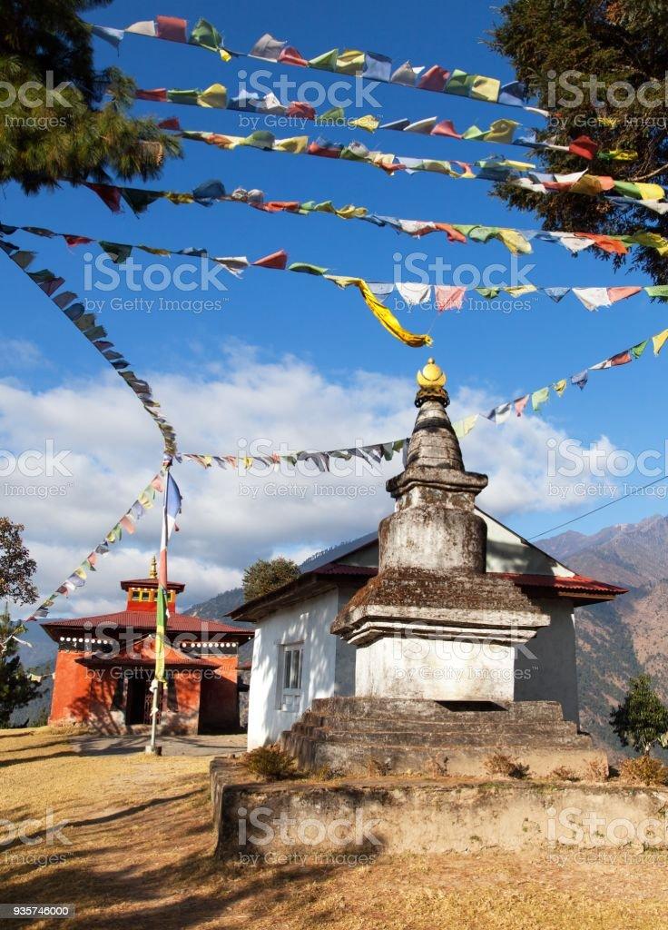 Bupsa gompa monastery and stupa with prayer flags stock photo