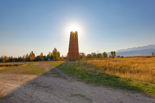 istock Burana tower which is an old and large minaret in the ruins of the ancient site of Balasagun, in Kyrgyzstan 1085616034
