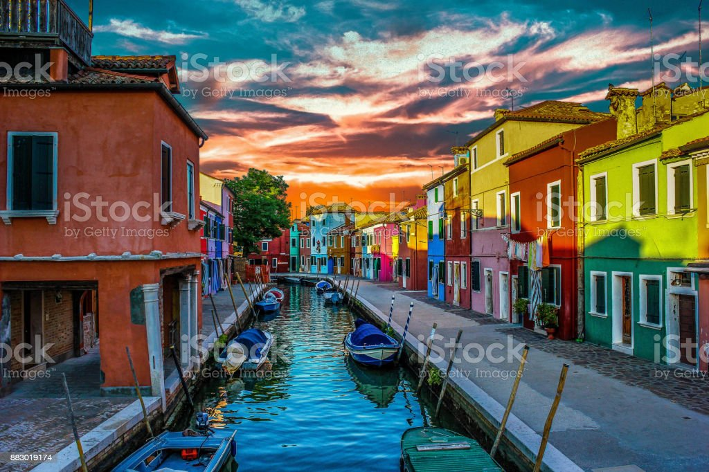 Burano Island's colorful houses on cloudy day stock photo