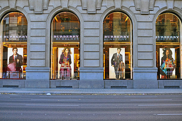Burberry flagship store, Barcelona, Spain Barcelona, Spain - December 9, 2014: Facade of Burberry flagship store in the street of Barcelona on December 9, 2014. Burberry is a luxurious clothing brand based in Great Britian.  gracia baur stock pictures, royalty-free photos & images