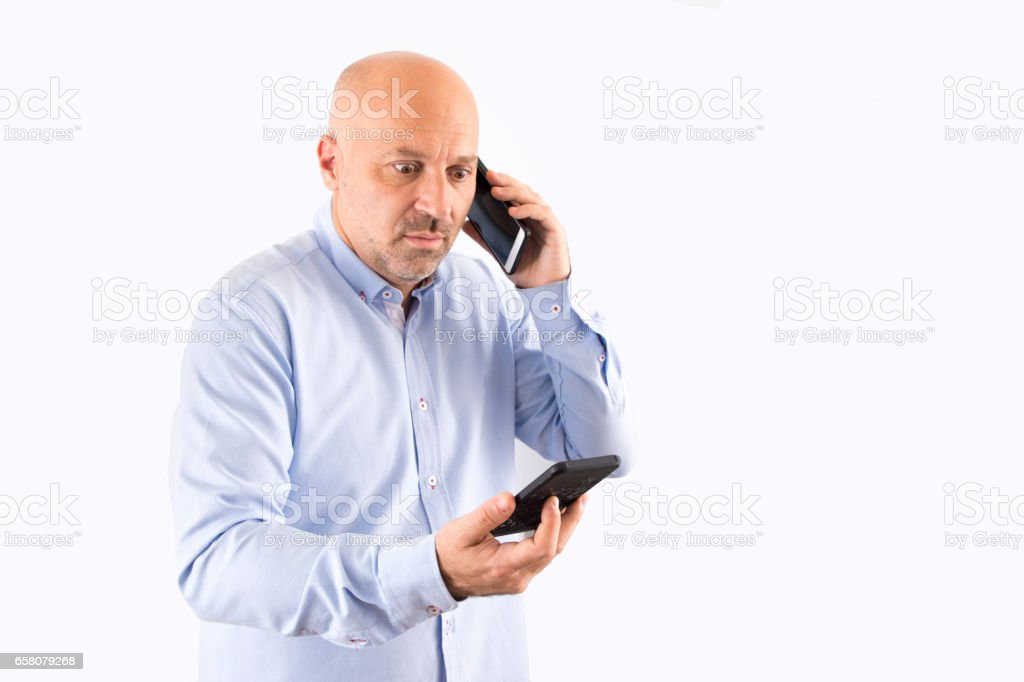Burdened with two phones royalty-free stock photo