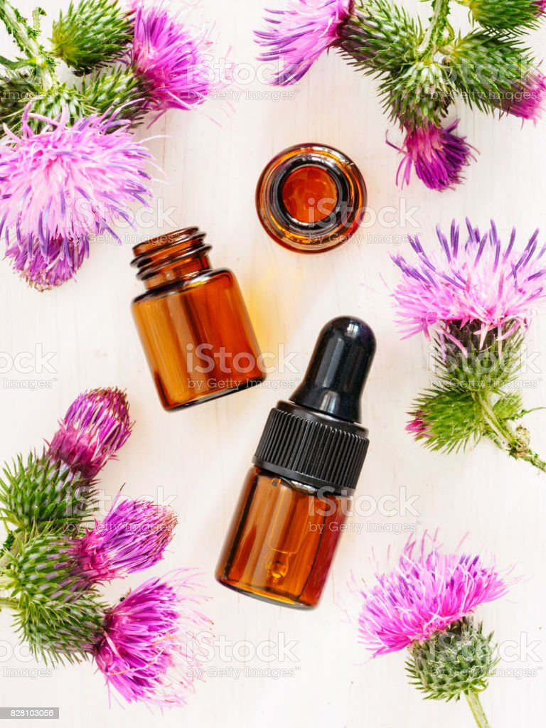 burdock oil in small glass bottle, top view stock photo