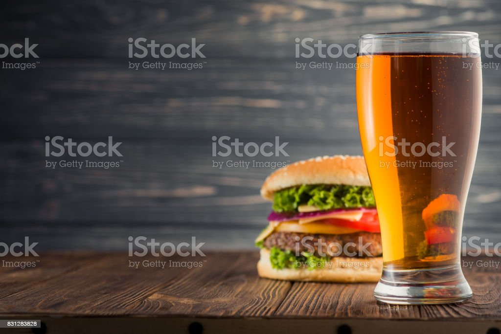 burger and beer stock photo