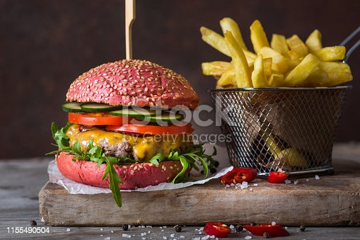 Homemade hamburger with french fries.