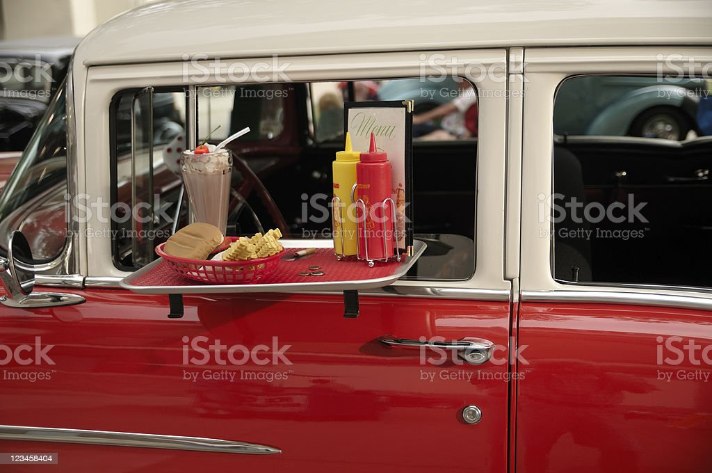 Burger and Fries on  Car Window Tray stock photo
