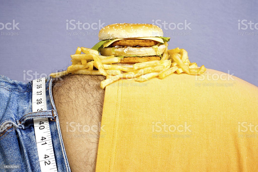Burger and fries placed on Tummy Junk Food Unhealthy royalty-free stock photo