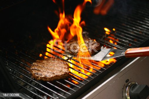 Hamburger patties grilling on the barbecue.